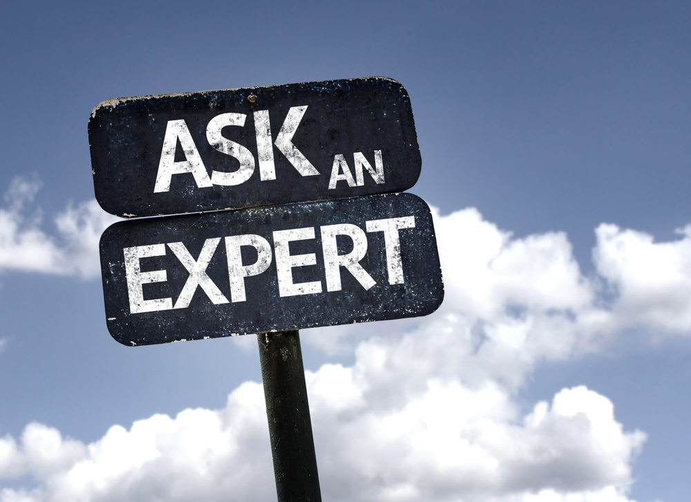 Ask An Expert sign with clouds and sky background .jpeg