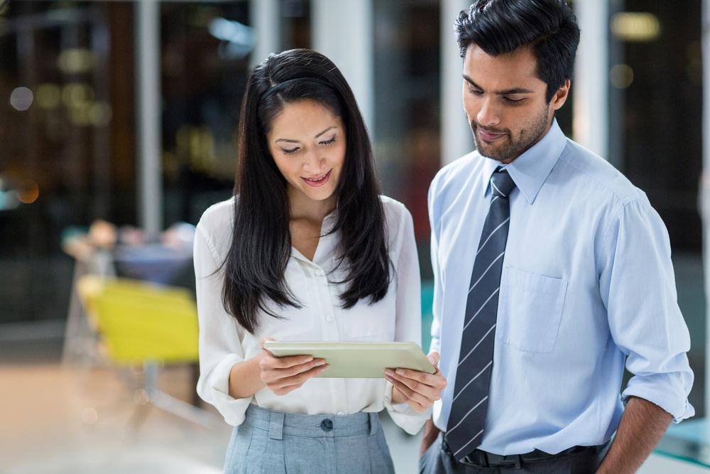 Business-man-woman-tablet-social-media-marketing-services-digital