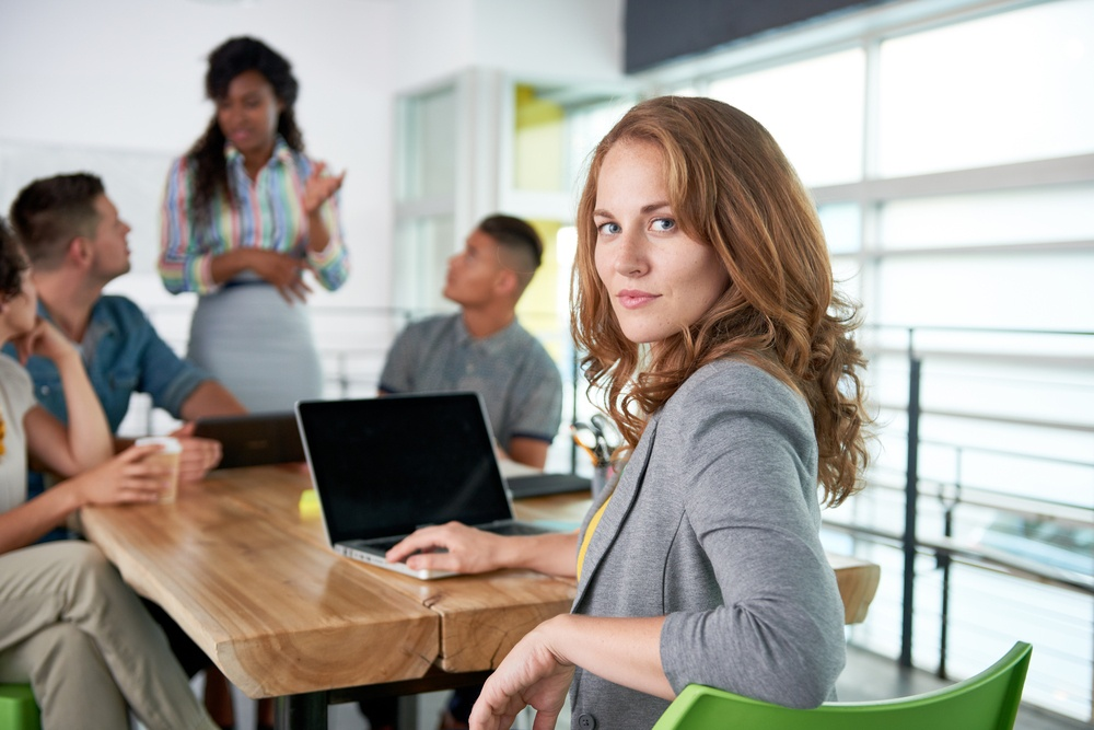 Image of a medical team and  woman using laptop during meeting.jpeg