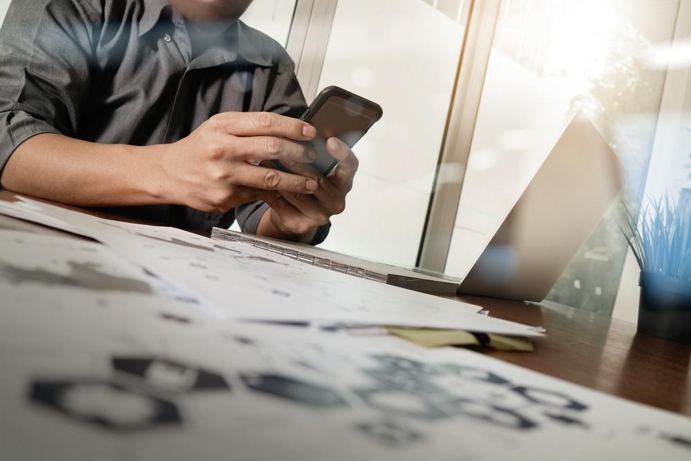 Medicine doctor hand working with modern computer and smart phone medical social media inbound marketing.jpeg