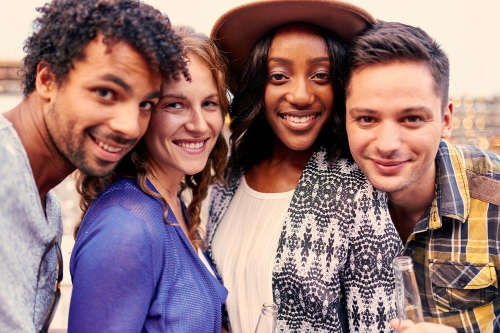 Multi-ethnic-millenial-group-friends-social-media-dental-smiles-marketing-plan