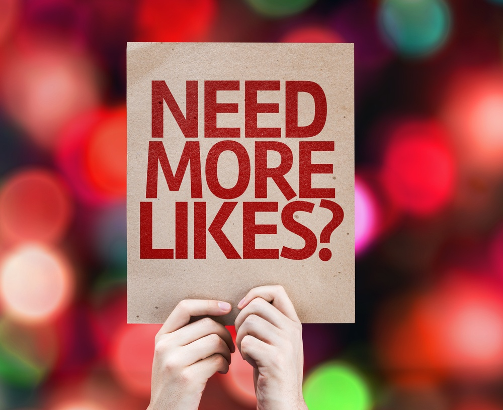 Need More Likes? written on colorful background with defocused lights social media paid advertising.jpeg