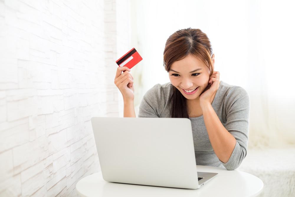 Woman enjoy online shopping paying by credit card.jpeg