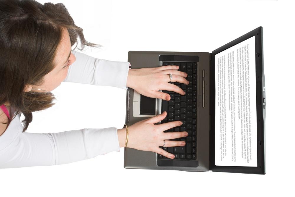 woman-blog-social-media-dental-marketing-plan-laptop-screen.jpeg