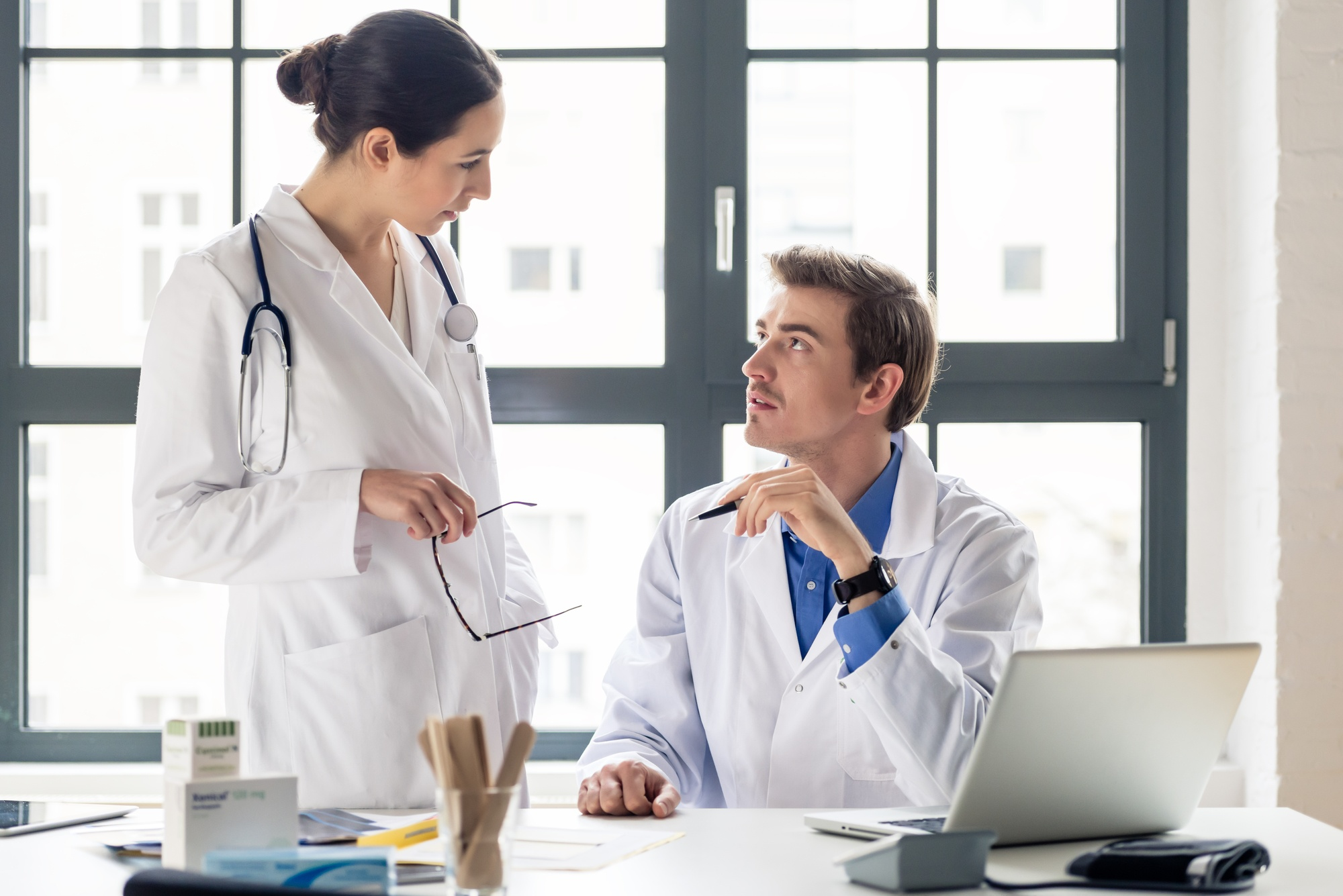 two doctors discussing medical marketing solutions pitfalls downfall social media emails paid social.jpg